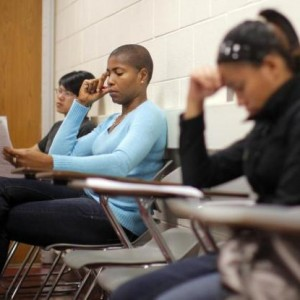 "Students listen to professor Christian Agunwamba during their ""Fundamentals of Algebra"" class at Bunker Hill Community College in Boston"