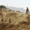 U.S. troops investigate the site of a suicide attack on a NATO base in Zhari