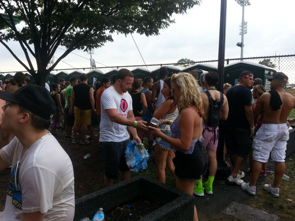 Volunteer Zookeepers Handed Out Water to Fans as the Exit the Festival