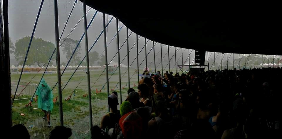 Fans Hide Under Tent on the Festival Grounds During the Heat of the Storm; Photo by Festival Goer Nick Roberts